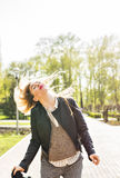 Happiness and craziness. Smiling crazy girl have fun outdoor. Young attractive woman with waving long hair playing in Stock Photo