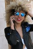 Happiness curly girl speaking at cellphone. Outside positive news cute Stock Images