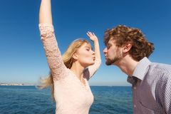 Dating. Couple in love kissing. Happiness dating concept. Couple in love blonde women handsome bearded men enjoy romantic date kissing, outdoor wide angle view royalty free stock photo