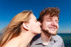 Dating. Couple in love kissing. Happiness dating concept. Couple in love blonde women handsome bearded men enjoy romantic date kissing, outdoor wide angle view royalty free stock image