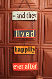Happiness door sign. And they lived happily ever after door sign on chain Stock Photos