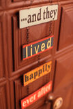 Happiness door sign. And they lived happily ever after door sign on chain Stock Images