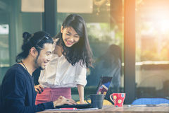 Happiness emotion of asian younger man and woman ,freelance team royalty free stock photo