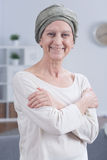 Happiness even in cancer. Portrait of senior woman in scarf on head with cancer in good humor Royalty Free Stock Images