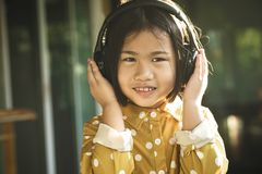 Happiness face of asian children listening music in head phone royalty free stock photography