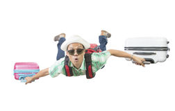 Happiness face of asian traveling man flying with two luggage ba Stock Images