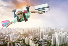 Happiness face of asian traveling man flying with two luggage ba Royalty Free Stock Images