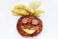 Happiness face of fried burger with fries, isolated. Stock Photography