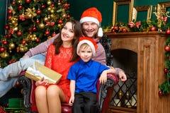 Happiness family celebrate x-mas in santa helper hats with many Royalty Free Stock Photo