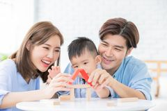 Happiness Family concept. Happy asian family playing with toy blocks and royalty free stock photo