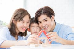 Happiness Family concept. Happy asian family playing with toy blocks and royalty free stock photography