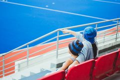 Mother and son outdoor hockey stadium royalty free stock image