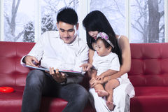 Happiness family read story book Royalty Free Stock Photo