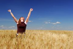 Happiness on the Farm. Happy woman in durum wheat field, brilliant summer sky Stock Photo