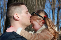 Happiness. Father kissing his daughter outdoors Royalty Free Stock Images