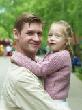 Happiness fatherhood. Happy father playing with daughter stock photo