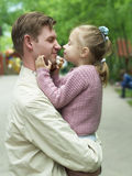 Happiness fatherhood. Happy father playing with daughter royalty free stock images