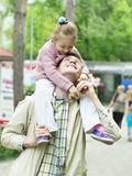 Happiness fatherhood. Happy father playing with daughter royalty free stock photography