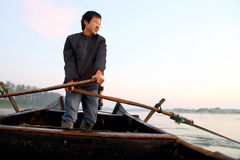 The happiness fisherman. An fisherman  rowed a boat Royalty Free Stock Image