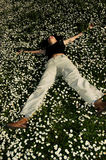 Happiness in the flowers 2. Happy girl rolling in the flowers Royalty Free Stock Image