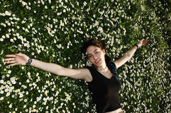 Happiness in the flowers 5. Girl in the flowers with a smile on her face royalty free stock photo