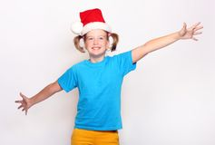 Happiness Girl in Christmas bonnet Stock Photo