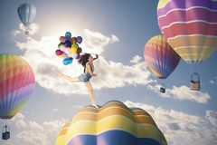 Happiness girl. Jumping over hot air balloon Stock Photography