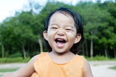 Happiness Girl. A little girl very happy in the garden Stock Image