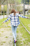 Happiness girl playing and walks by old rail trail. Stock Photos