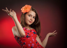 Happiness girl in studio with flower in hair Stock Images