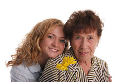 Happiness grandmother and granddaughter. On a white background Royalty Free Stock Photo
