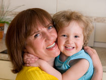 Happiness grandmother with granddaughter. Happiness embracing grandmother with granddaughter Royalty Free Stock Image