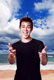 Happiness handsome young man posing over sea Royalty Free Stock Photography