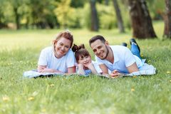 Happiness and harmony in family life. Happy family concept. Young mother and father with their daughter in the park. Happy family. Carefree, happylife royalty free stock photos