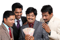 Happiness Indian business team with Indian money Stock Photo