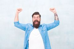 Happiness and joy. Hipster with beard and mustache happy expression. Brutal handsome hipster man on grey wall background royalty free stock image