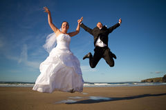 Happiness jump. Wedding photo session in irish scenery Royalty Free Stock Images