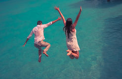 Happiness jump of couple Royalty Free Stock Images
