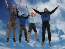 Happiness jumping people. Four happiness flying people on blue Stock Photography