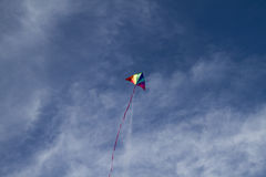 Happiness, Kite of rainbow colors on a blue sky with light white Stock Photo