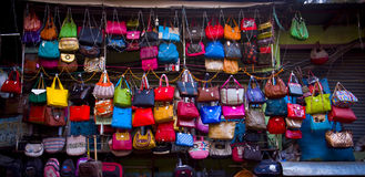 Happiness of the lady. Colorful hand bag on market Stock Photography