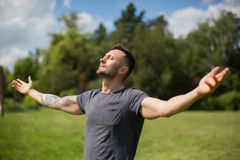 Happiness. laughing man on a meadow Royalty Free Stock Images