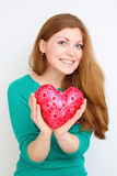 Happiness and love concept. Happy red hair woman holding valentine heart Royalty Free Stock Photos