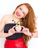 Happiness and love concept. Happy red's woman holding valentine heart. Valentines day Stock Image