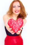 Happiness and love concept. Happy red's woman holding valentine heart. Valentines day Royalty Free Stock Photography