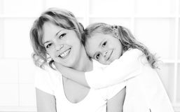 Happiness is love is happiness. Woman and little girl cuddling - monochrome love and happiness concept Royalty Free Stock Photo
