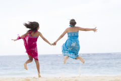Happiness Mother and Girl Jumping Stock Photo
