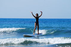 Girl on surf board Royalty Free Stock Images