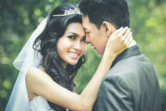 Happiness of newlywed couple. Close up portrait of happiness of young newlywed couple Royalty Free Stock Photography