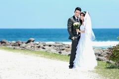 Happiness of newlywed couple at seashore Stock Photography